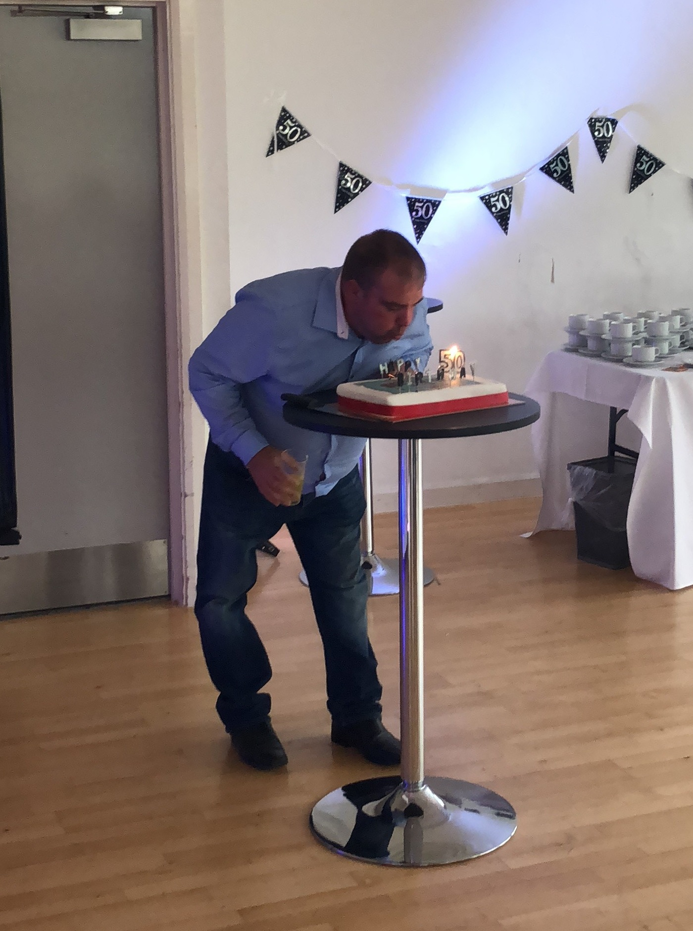 blowing-out-candles-1 Mr R Cleaning Turns 50!